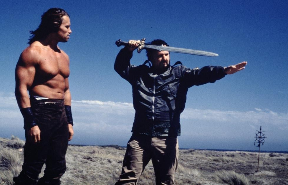 e09820c8_Milius-on-the-set-of-Conan-with-Schwarzenegger